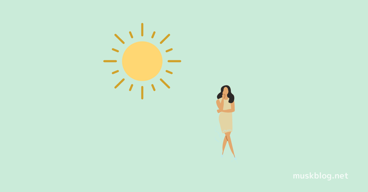 立っている女性と太陽